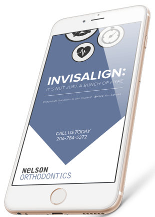 Inner preview of our free eBook about Seattle Invisalign treatment as displayed on an iPhone, title Invisalign: It's Not Just A Bunch of Hype.